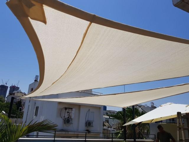 מיפרשי הצללה בגג תא