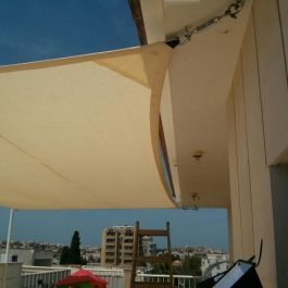 sa2xg251.das_רשת צל על גג בעיר